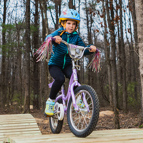 Young girl riding bike on the Touch of Nature Kids Terrain Track